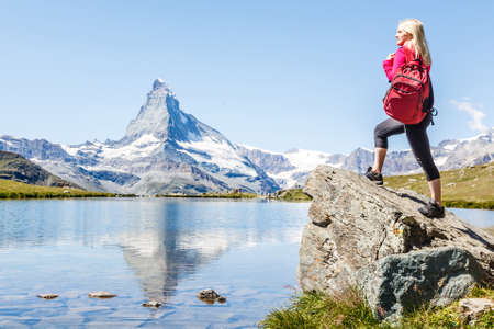 woman looking at the beautiful Mount Matterhorn in the Swiss Alps