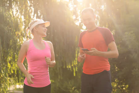 Urban sports - couple jogging for fitness in the city on a beautiful summer day Standard-Bild