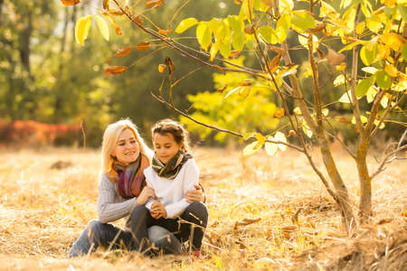 Mom with her daughter during autumn
