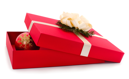 Red gift box with white ribbon and christmas toy isolated on white color background. Фото со стока