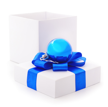 White gift box with blue  ribbon and toy isolated on white color background Фото со стока