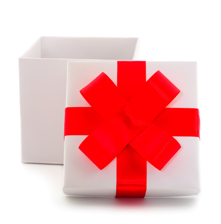White gift box with red ribbon isolated on white color background.