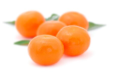Five tangerines isolated closeup. On white background.