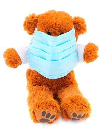 Teddy bear in a protective medical mask.The toy got sick. Playing doctor. Protection from viruses, influenza, coronavirus for children.