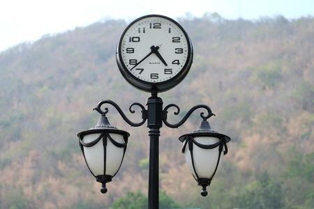 lamp post: Clock & lamp post in Thailand Stock Photo