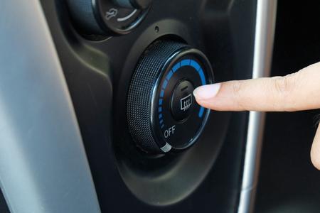 recirculate: Finger pressing car defrost button