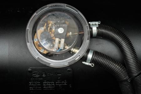 lpg: black car liquefied petroleum gas, LPG tank with meter close up