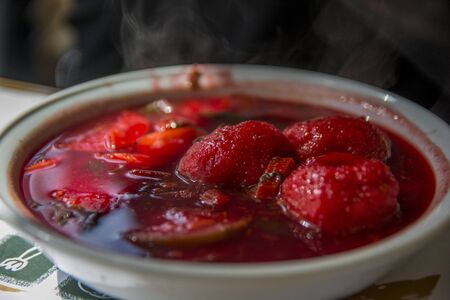Traditional hot red beet Kubbe soup, a famous middle eastern dumplings soup dish, served in a bowl. Jerusalem, Israel.