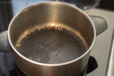 Empty burnt pot with black bottom Stock Photo
