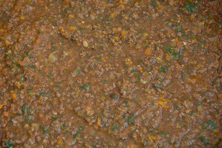Close up view of an homemade Bolognese sauce (Ragù alla Bolognese) with fresh basil (Ocimum Basilicum) Stock Photo