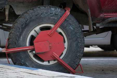 Close up of a red Wheel clamp