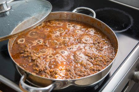 Homemade traditional Bolognese sauce (Ragù alla Bolognese) in a pot