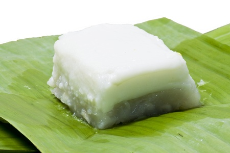 Taro custard topped with coconut layer on banana leaf