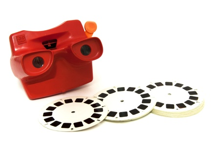 3D slide viewer,  toy camera with the 3D film reels, isolated Stock Photo - 15153039