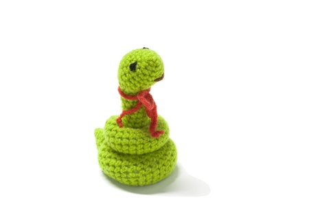 CROCHET SNAKE DOLL WITH RED SCARF Stock Photo