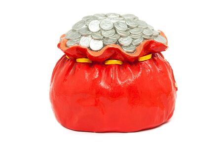 Coin pile in red bag isolated, made from plaster photo