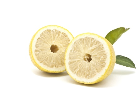 Half Japanese lemon isolated on white background