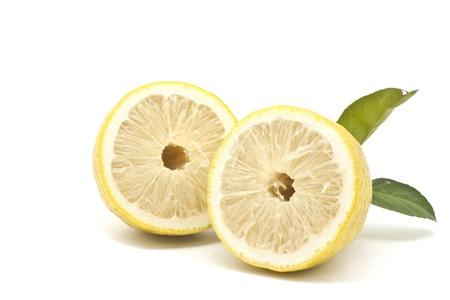 Half Japanese lemon isolated on white background