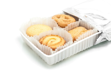 Assorted cookie in plastic box , isolated on white