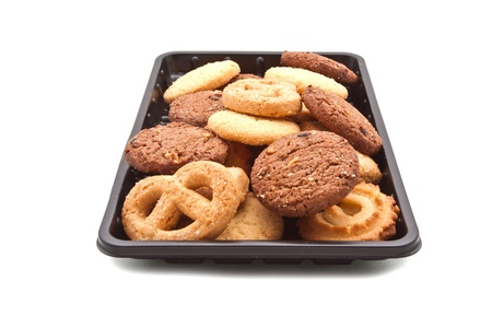 cikolatali: Heap of Cookie on black plastic tray, isolated on white
