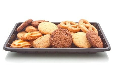 Heap of Cookie on black plastic tray, isolated on white Stock Photo - 17798332