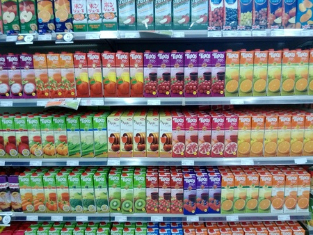 Variety of juices are shown in a supermarket shelfs in Bangkok Thailand