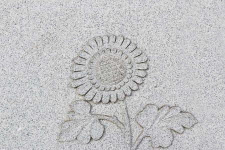 emboss: Emboss sunflower on grey wall, Horizontal
