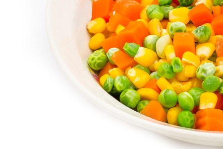 Mix vegetables in a bowl on white background