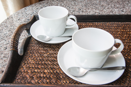 Two coffee cup in woven tray