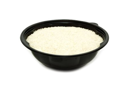 Rice Grain in Bowl Isolated on White