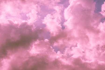 Pink and purple sky background with clouds