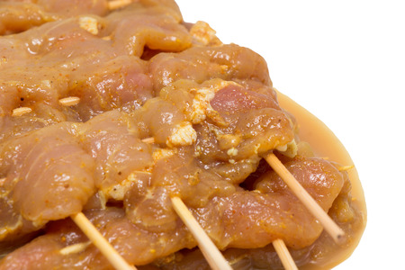 Raw marinated meat for pork bbq skewer on white background