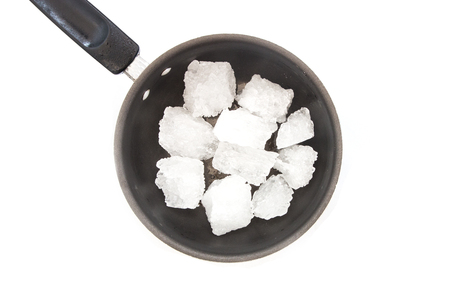 Group of rock sugar in a pot on white background Stok Fotoğraf