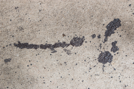 Cement surface with oil stain texture