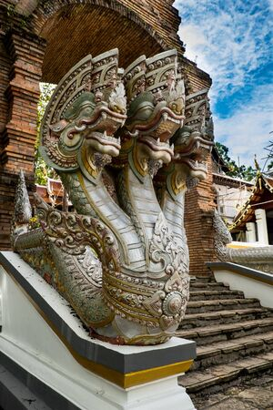 serpents: Serpent statue. The pole and rail stair of a temple in the north of thailand. Stock Photo