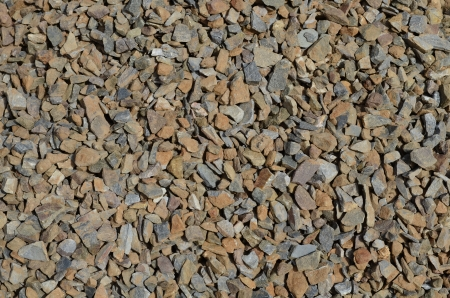 seepage: crushed stones , wallpaper Stock Photo