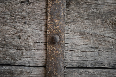 Vintage wooden door with metal belt  photo