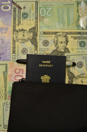 Indian passport with American and Canadian dollars photo