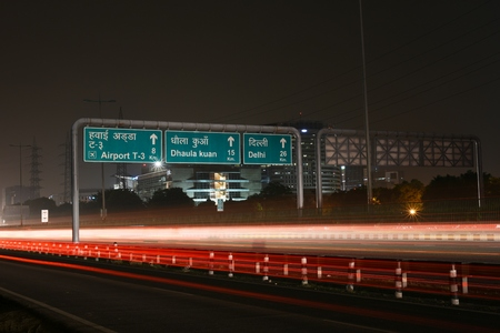 delhi: Speeding cars on modern Road infrastructure in Gurgaon, Delhi, India. Artistic long exposure shot at night Stock Photo