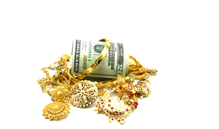fx: US dollars or Money and Gold Jewelry, Concept of spending money on gold, or rise in price of Gold, or taking loan by pawning gold jewelry Stock Photo