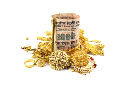 rupee: Indian Rupee or Money and Gold Jewelry, Concept of spending money on gold, or rise in price of Gold, or taking loan by pawning gold jewelry