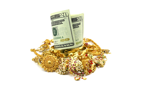us dollars: US dollars or Money and Gold Jewelry, Concept of spending money on gold, or rise in price of Gold, or taking loan by pawning gold jewelry Stock Photo