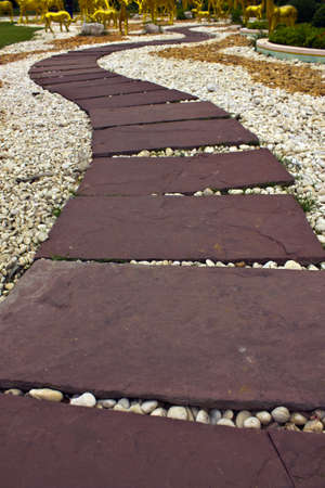 stockade: Stock Photo - red stone paved roads in the park