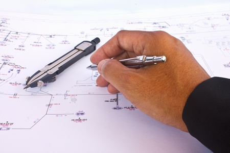Stock Photo - architect draws a blueprint photo