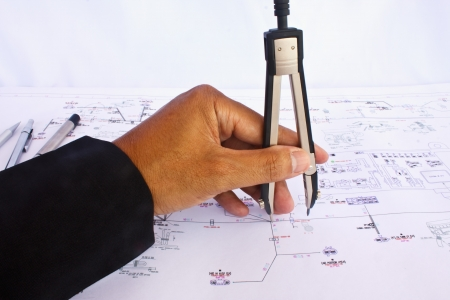 Stock Photo - architect draws a blueprint Stock Photo