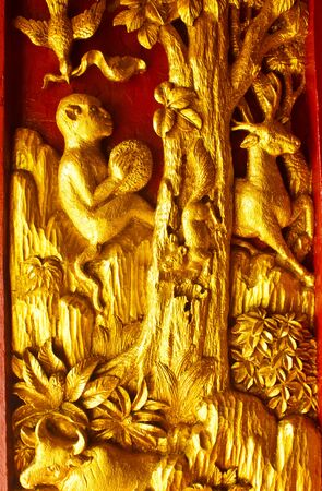 Stock Photo - Door wood carving art Angel, Ancient temple in the South of the country, Thailand photo