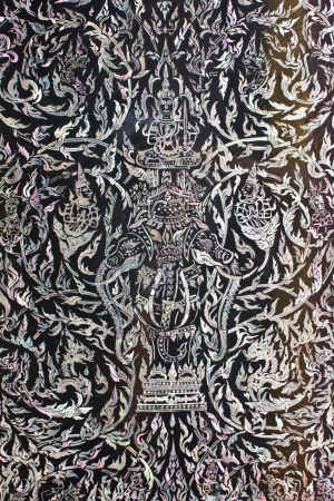 Stock Photo - Thai art made from pearl on the door of Rarchabophit temple Thailand.