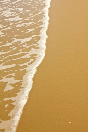 Stock Photo -sea wave on golden beach Stock Photo
