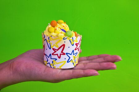 colorful of Cupcake on women hand Stock Photo
