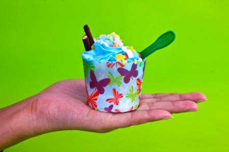 afternoon fancy cake: colorful of Cupcake on women hand Stock Photo
